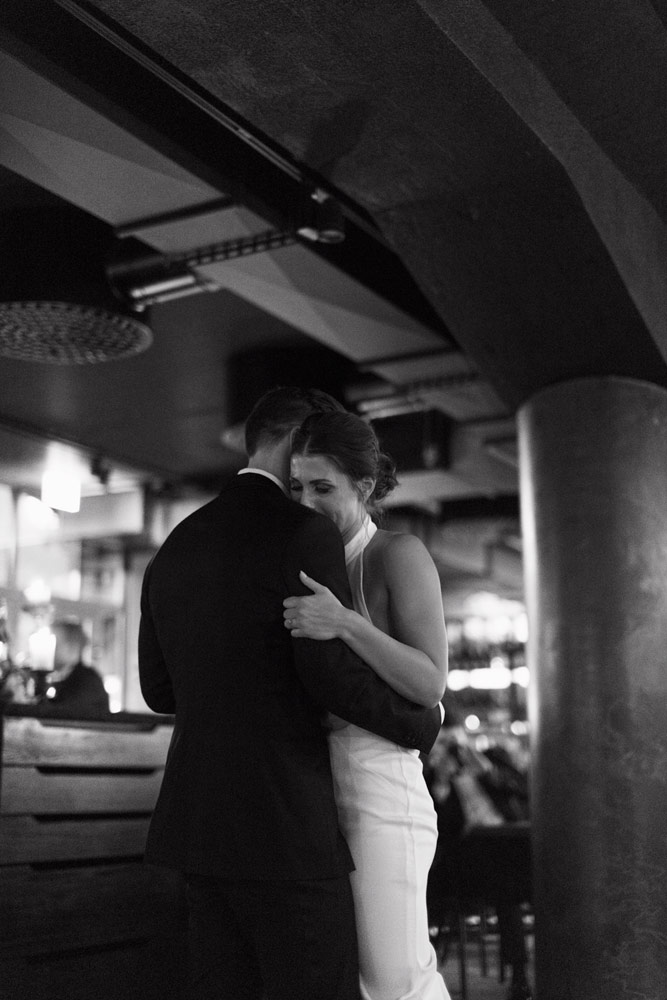 Winter wedding in moody restaurant shelter in Helsinki, Finland.